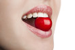 Young woman mouth with red cherry closeup