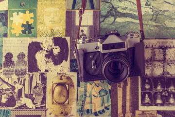 Retro camera hanging on the wall with clippings from magazines.