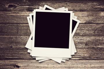 collection of Polaroid retro frames on wood