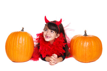 girl in halloween  fancy dress lying on the floor