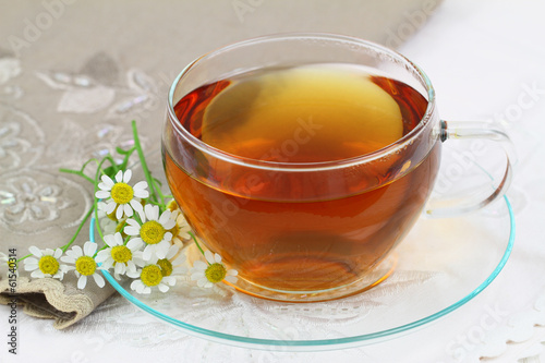 Tea and fresh chamomile flowers