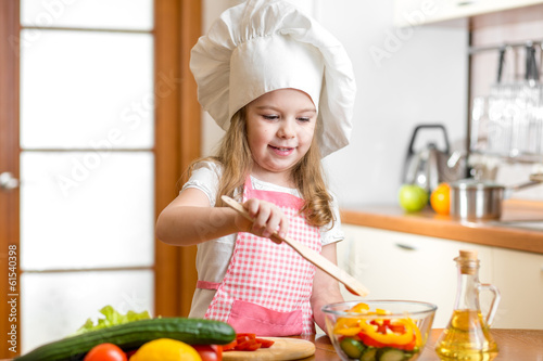 kid cooking at kitchen