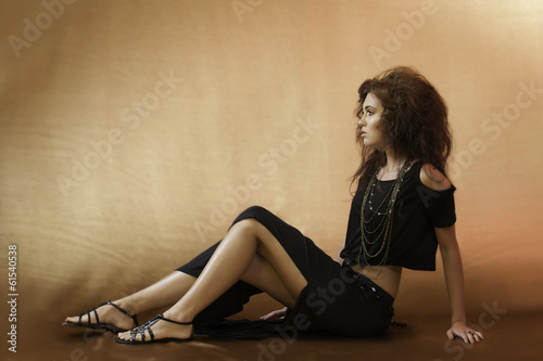 Sensual woman in black with wild auburn hair