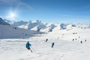 Skiers enjoy in the mountain on a sunny day