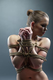 Image of lovely naked girl with her hands tied