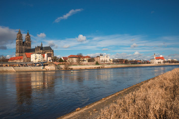 Magnificent Cathedral of Magdeburg at river Elbe with blue sky,