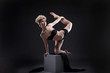 Studio shot of graceful slim model dancing on cube