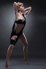 Graceful girl dancing in black erotic lingerie
