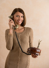 Happy elegant woman talking on retro telephone