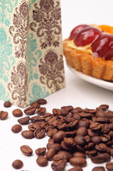 Coffee beans with fruit tartlet