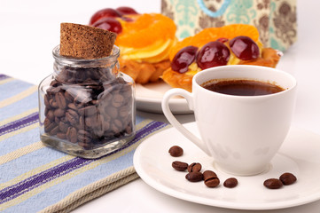 A cup of coffee and a fruit tartlet