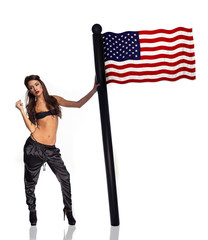 Beautiful patriotic woman with an American flag