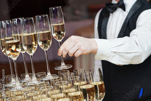 Waiter with glass of champagne