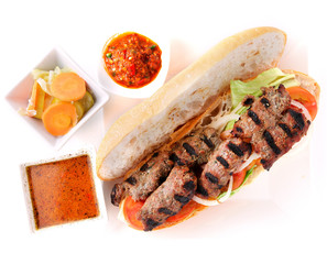 Grilled beef sandwich with sauce.