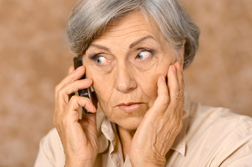 Aged woman talk on phone