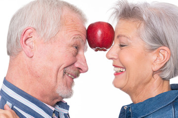 Senior couple with apple