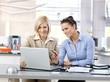 Businesswomen working together at modern office