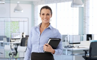 Elegant middle-aged businesswoman at office