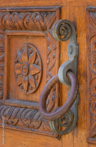 Old wooden gate with rusty iron handle