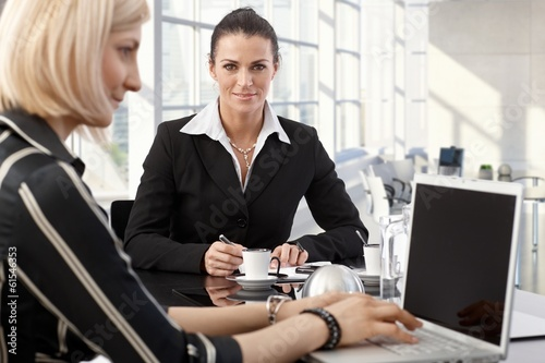 Elegant mature businesswoman on business meeting