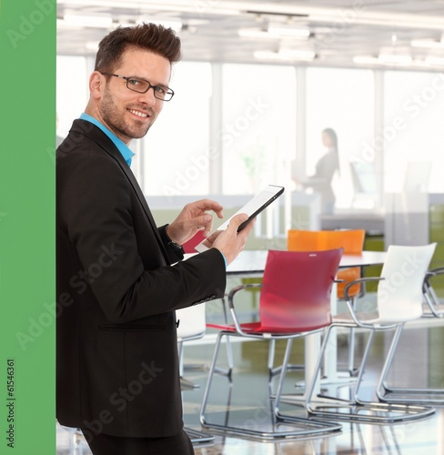 Businessman working in colorful office