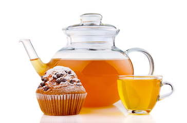 Cup and glass teapot with cake isolated on white
