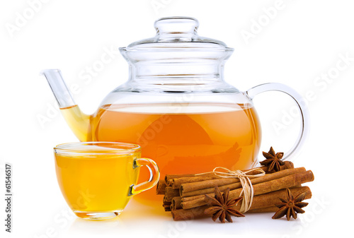 Cup and glass teapot with spices isolated on white
