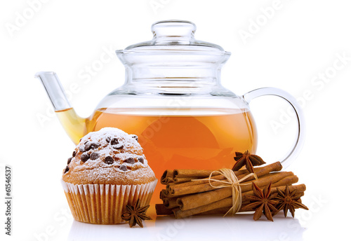 Glass teapot with spices and cake isolated