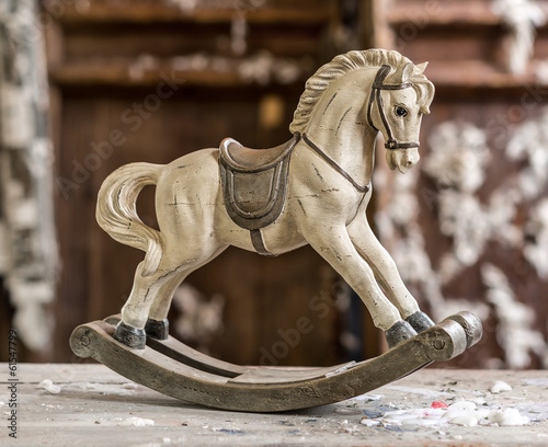 Fotobehang Retro Vintage old rocking horse on a wooden background