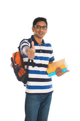 young indian college male with thumbs up