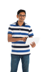 indian casual male with a tablet on white background
