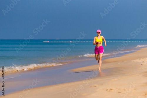 Healthy Woman running on beach