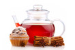 Teapot with hibiscus tea, spices and cake isolated
