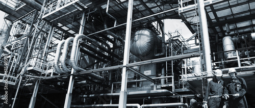 oil and gas workers inside petrochemical refinery