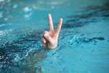 victory or peace symbol,above water surface - body language
