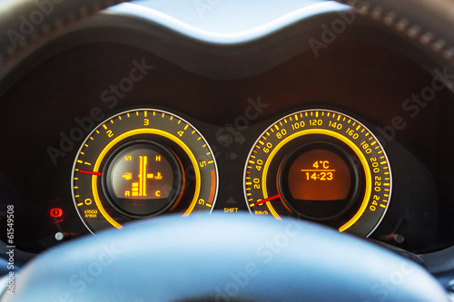 Car dashboard with illuminated instrument panel