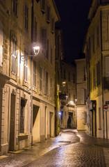 A street in night Avignon - France