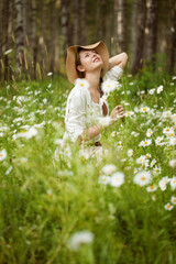 Girl in the meadow of daisies