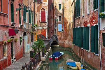 Typical venetian canal among old building.