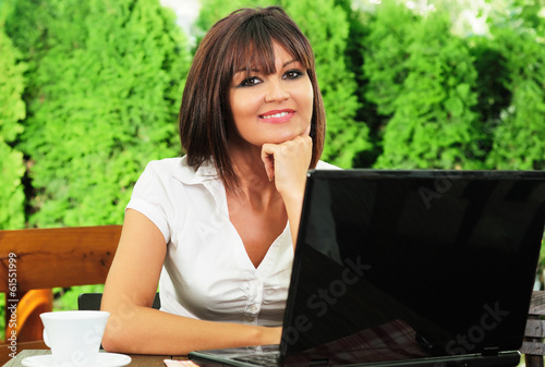 Businesswoman on coffee break posing