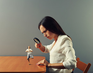 woman looking with magnifying glass