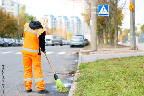 Road sweeper cleaning street with broom tool