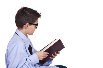 young man in business clothes reading the book