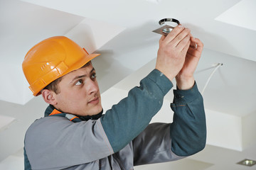 Electrician at spot light installation