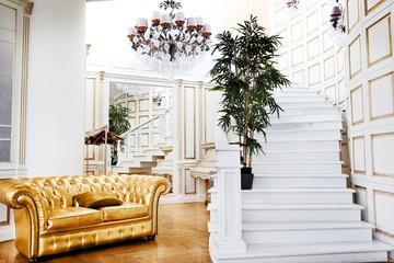 Beautiful vintage gold sofa next to wall (retro-style illustrati