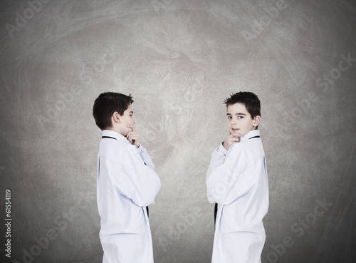 Young boys wearing business clothes talking and discussing