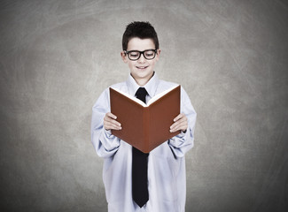 young man in business clothes with open book reading