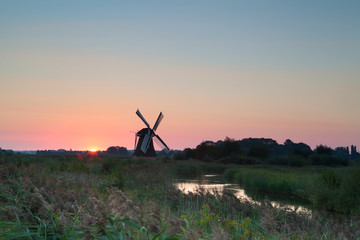 Dutch windmill at sunrise