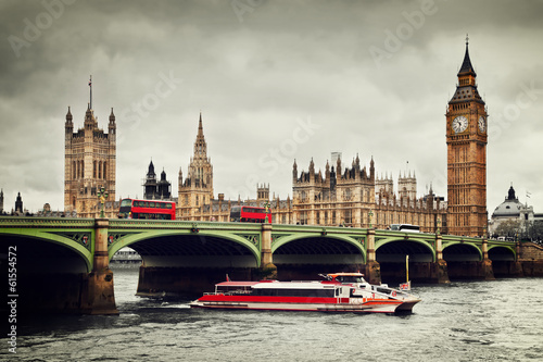 London, the UK. Big Ben, the River Thames, red buses and boat