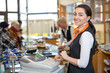 Shopkeeper and saleswoman at cash register or cash desk